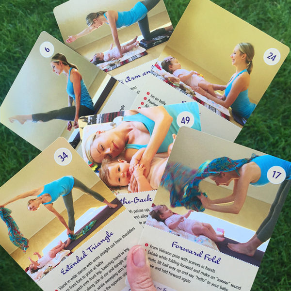 sing and play yoga cards in a hand